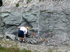 This is a more distant view of the Figure 170 and the interbedded chert rich intraclastic packstone and mudstone fabrics, the chert probably being associated with overlying exposure and soil horizon development of the Lower Mississippian Newman Limestone Formation. Note the 101-paint mark of unit 101 of the measured Geological Section, Kentucky Geological Survey Field Trip Guide, 1998