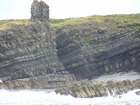 Exposures of Ross Formation in the cliffs at Leck Point in vicinity of the ruins of the Castle west and south of Drom in Co Kerry (Pyles, 2007). These Namurian outcrops turbiditic sands can be accessed by road and across the cow pastures at Drom.