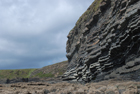 Exposures of Ross Formation in cliffs at Leck Point with its ruined Castle west and south of Drom in Co Kerry (Pyles, 2007). These Namurian outcrops of turbiditic sands are accessed by road and then a gulley to the beach through the cow pastures at Drom.