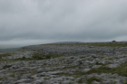 Karst pavements and topography of the Burren approx 5km south of Ballyvaughan Co Clare Ireland. Exposures of the Dinantian Burren Limestone Formation are composed of shallow water carbonates. Note the clints (limestone blocks) and grikes (joints formed by Variscan folding (Coller, 1984) and fracturing) enlarged by Pleistocene disolution (Williams, 1966).