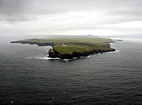 Loop Head seen from the west and photographed by David Pyles from a hellicopter. The Shannon Estuary is to the right or south and the Atlantic to the left or north